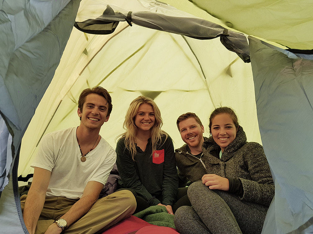 Four people in a tent